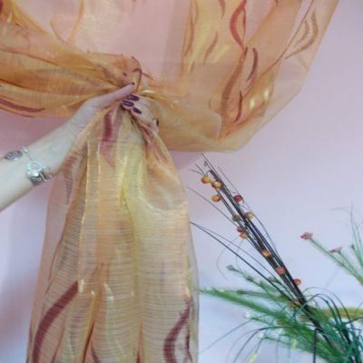 Cream organza curtain with grey and gold pattern
