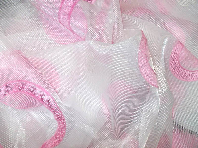 The white curtain with pink circles