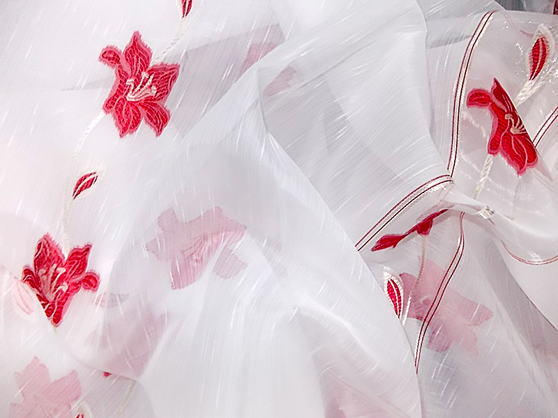 White curtain with red flowers